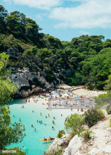cala macarelleta - naturist stock pictures, royalty-free photos & images