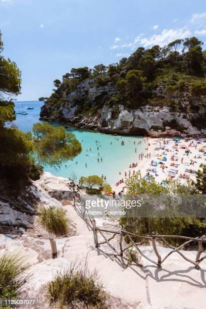cala macarelleta with people in summer, menorca - カラマカレラ ストックフォトと画像