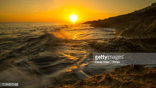cala mesquida sunrise - sonne stock pictures, royalty-free photos & images