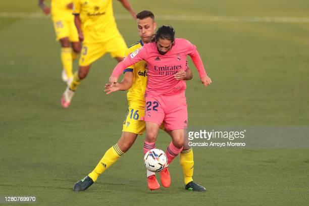 Cala of Cadiz CF tackles rmduring the La Liga Santander match between Real Madrid and Cadiz CF at Estadio Santiago Bernabeu on October 17, 2020 in...
