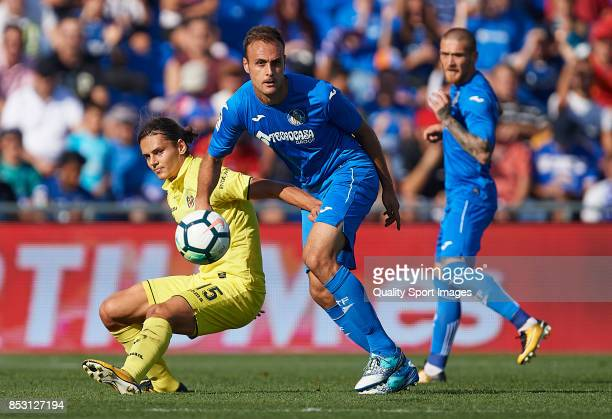 Cala of Getafe competes for the ball with Enes Unal of Villarreal during the La Liga match between Getafe and Villarreal at Coliseum Alfonso Perez on...
