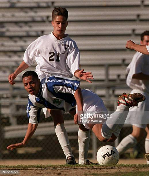 Calabasas High's Amir Benakote upends Guadalupe Nicholas of Littlerock High during their soccer match today