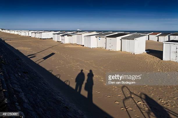 Calais beach huts shadows