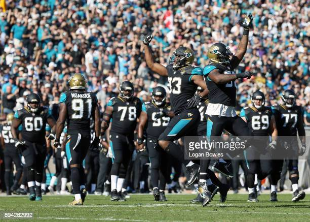 Calais Campbell and Malik Jackson of the Jacksonville Jaguars celebrate a play during the second half of their game against the Houston Texans at...