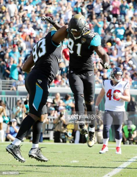 Calais Campbell and Yannick Ngakoue of the Jacksonville Jaguars celebrate a play during the second half of their game against the Houston Texans at...