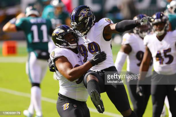Calais Campbell celebrates with Matt Judon of the Baltimore Ravens after sacking Carson Wentz of the Philadelphia Eagles during the second quarter at...