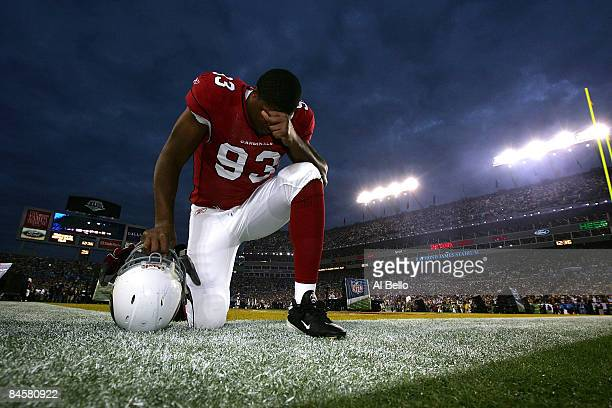 Calais Campbell of the Arizona Cardinals kneels on the field before taking on the Pittsburgh Steelers during Super Bowl XLIII on February 1, 2009 at...