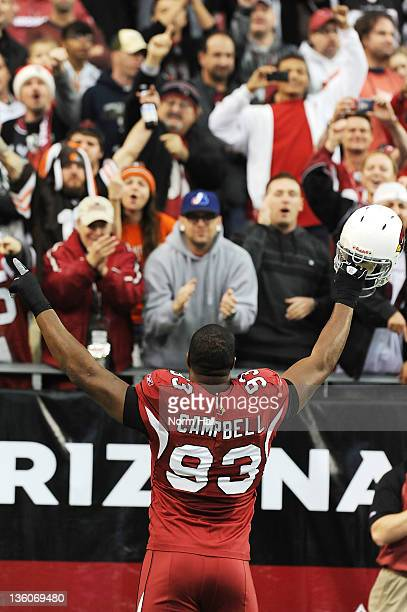 Calais Campbell of the Arizona Cardinals pumps up the crowd just prior to the kickoff against the Cleveland Browns at University of Phoenix Stadium...