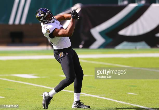 Calais Campbell of the Baltimore Ravens celebrates sacking Carson Wentz of the Philadelphia Eagles during the first quarter at Lincoln Financial...