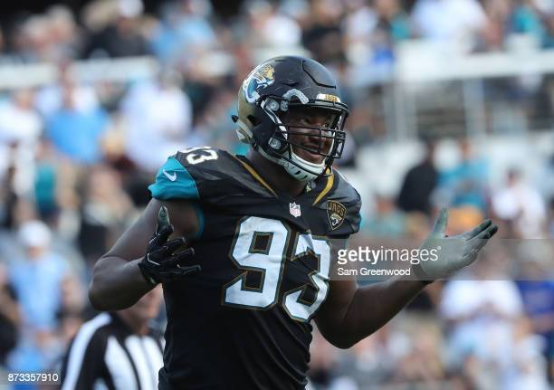 Calais Campbell of the Jacksonville Jaguars celebrates a play in the second half of their game against the Los Angeles Chargers at EverBank Field on...