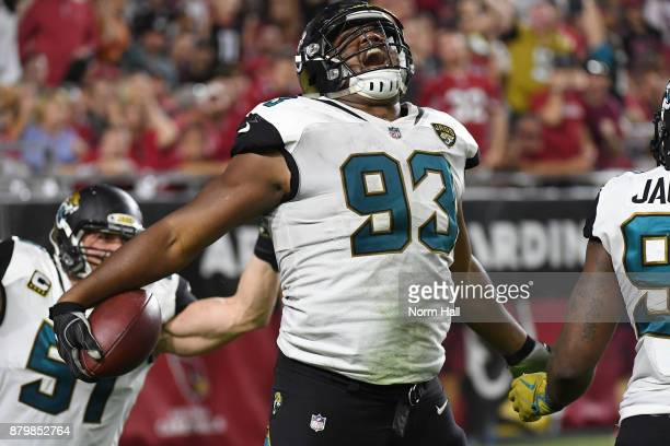 Calais Campbell of the Jacksonville Jaguars celebrates a ten yard fumble recovery touchdown against the Arizona Cardinals in the second half at...