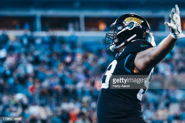 Calais Campbell of the Jacksonville Jaguars celebrates a touchdown against the Indianapolis Colts in the fourth quarter at TIAA Bank Field on...