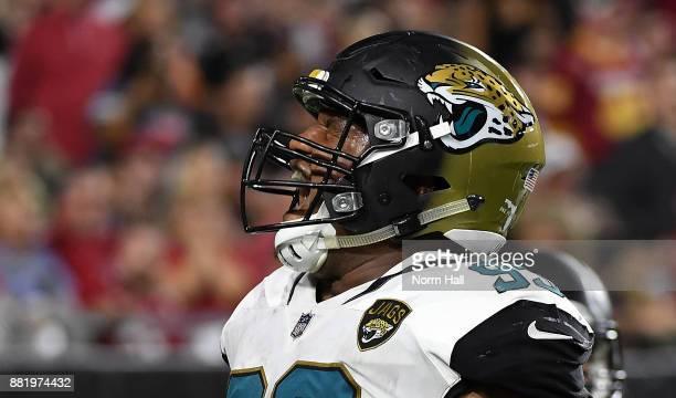 Calais Campbell of the Jacksonville Jaguars celebrates scoring a touchdown against the Arizona Cardinals at University of Phoenix Stadium on November...