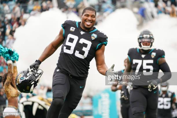 Calais Campbell of the Jacksonville Jaguars enters the field with his team before the start of a game against the Los Angeles Chargers at TIAA Bank...