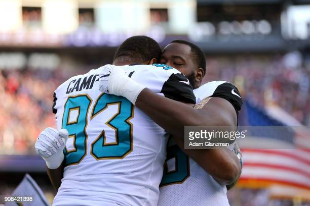 Calais Campbell of the Jacksonville Jaguars hugs a teammate before the AFC Championship Game against the New England Patriots at Gillette Stadium on...