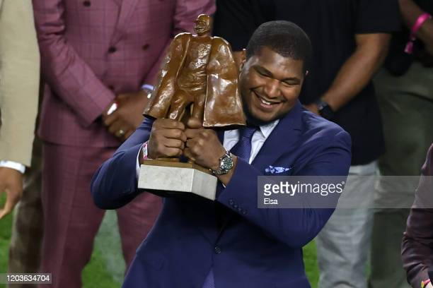 Calais Campbell of the Jacksonville Jaguars is awarded the Walter Payton NFL Man of the Year Award prior to Super Bowl LIV between the San Francisco...