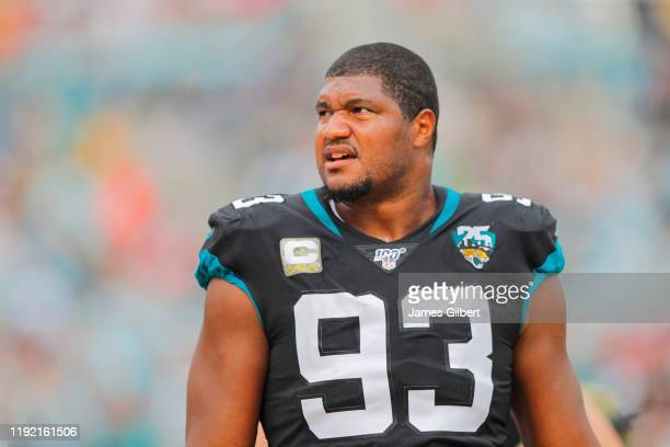 Calais Campbell of the Jacksonville Jaguars looks on from the sidelines during the second quarter of a game against the Tampa Bay Buccaneers at TIAA...
