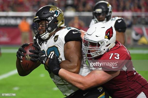 Calais Campbell of the Jacksonville Jaguars runs with the football to score a ten yard touchdown against the Arizona Cardinals after a fumble in the...