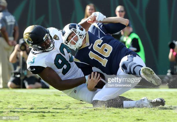 Calais Campbell of the Jacksonville Jaguars sacks Jared Goff of the Los Angeles Rams in the first half of their game against the Jacksonville Jaguars...