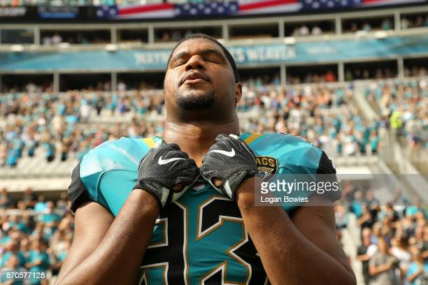 Calais Campbell of the Jacksonville Jaguars waits in the bench area prior to the start of their game against the Cincinnati Bengals at EverBank Field...