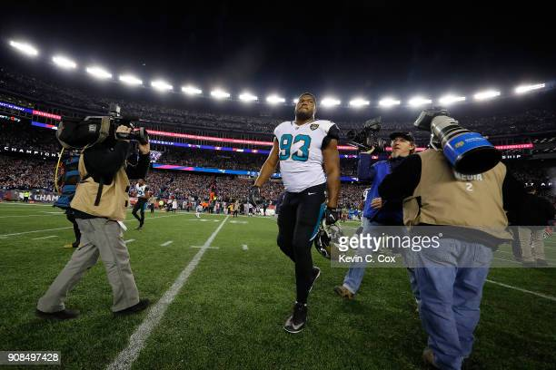 Calais Campbell of the Jacksonville Jaguars walks offsides the field after the AFC Championship Game against the New England Patriots at Gillette...