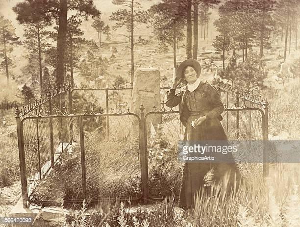 Calamity Jane at the Grave of Wild Bill Hickok in Deadwood South Dakota by photographer JA Kumpf albumen silver print circa 1903