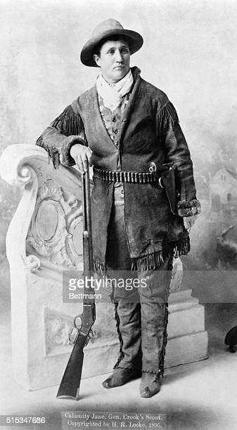 Calamity Jane standing with rifle Undated photograph