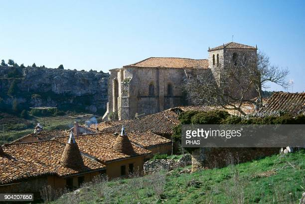 Calatañazor province of Soria Castile and Leon Spain Church of Nuestra Señora del Castillo of Romanesque style origins Typical stone houses with...