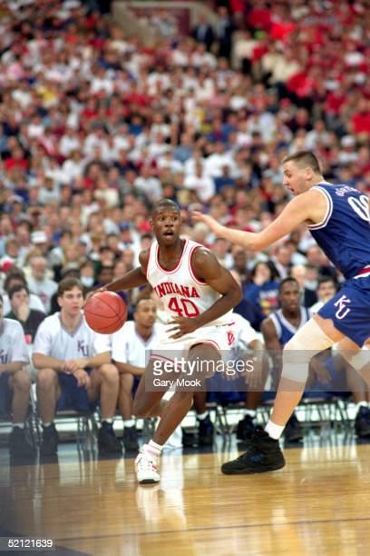 Calbert Cheaney of the Indiana University Hoosiers moves the ball during an NCAA game against the University of Kansas Jayhawks on December 5 1992...