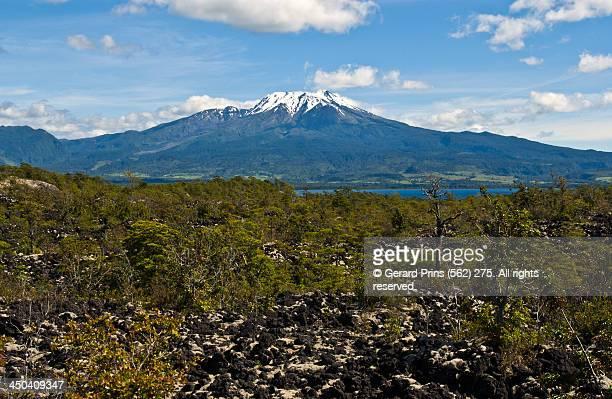 calbuco volcano seen across llanquihue lake - calbuco volcano stock pictures, royalty-free photos & images