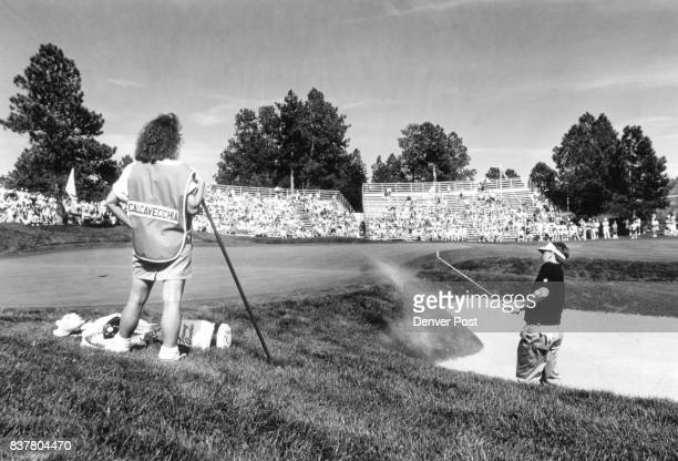 Calcavecchia Mark Sheryl Mark Calcavecchia chips out of the sand trap on the 18th hole as his wife also his caddy looks on Credit The Denver Post
