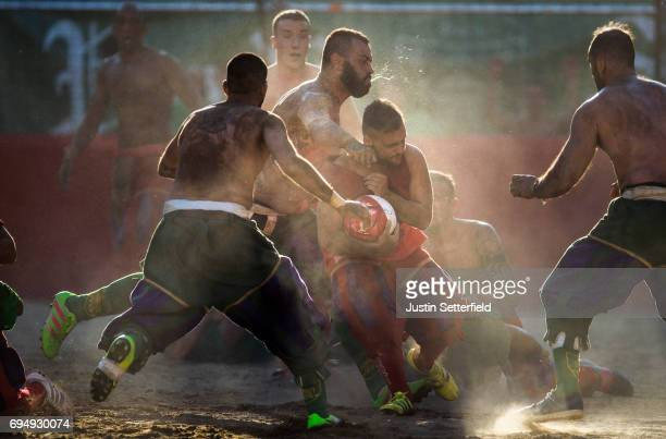 Calcianti of Santa Maria Novella Rossi Team take on San Giovanni Verdi Team during the semifinal match of the Calcio Storico Fiorentino at Piazza...
