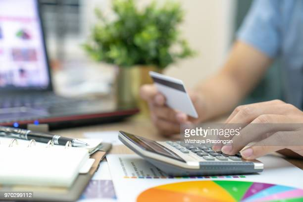 calculate how much cost or spending have with credit cards - fee stock pictures, royalty-free photos & images