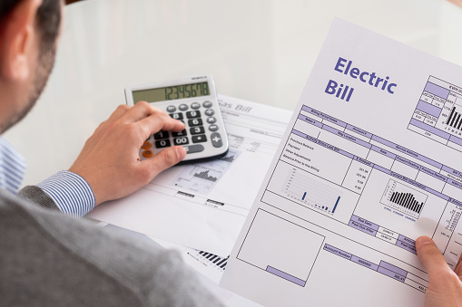 Calculating energy efficiency and energy bill papers 1171694344