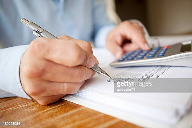 calculating finances - calculator stock photos and pictures