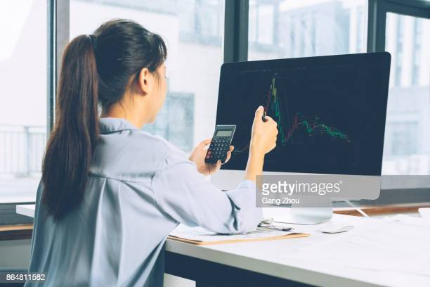 calculating on calculator - accounting stock photos and pictures