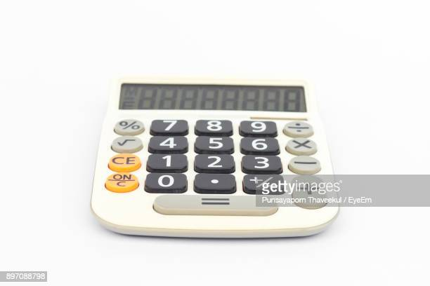 calculator against white background - calculator stock photos and pictures