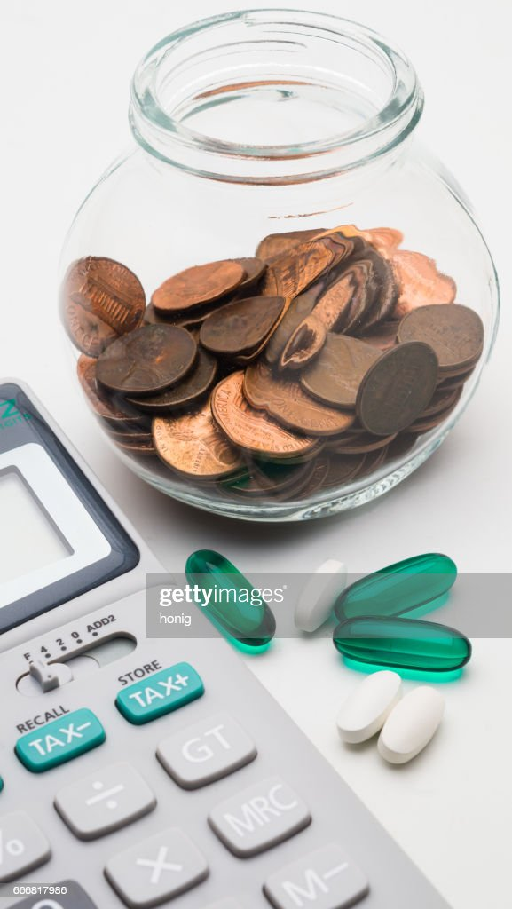 Calculator And 1 Cent Coins In Glass Jar On White Background The