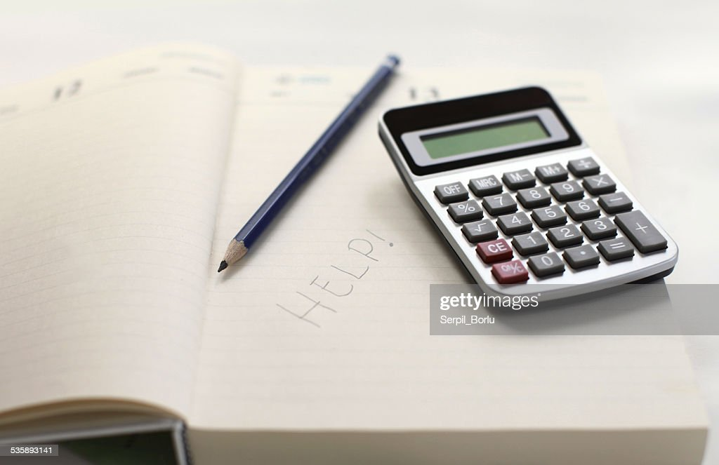 calculator and help note : Stock Photo