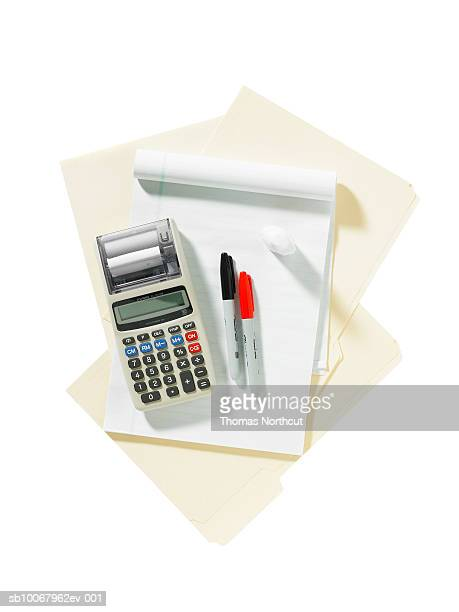 calculator and office supplies on white background - correction fluid stock pictures, royalty-free photos & images