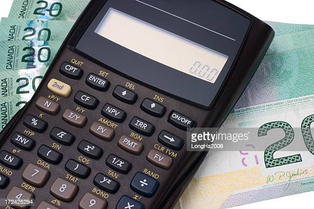 a calculator and paper money notes - canadian currency stock pictures, royalty-free photos & images