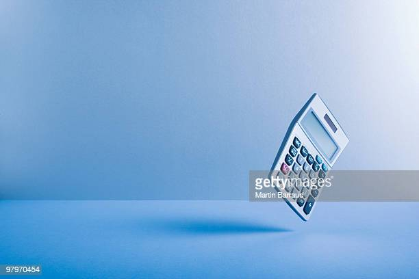 calculator falling - calculator stock photos and pictures