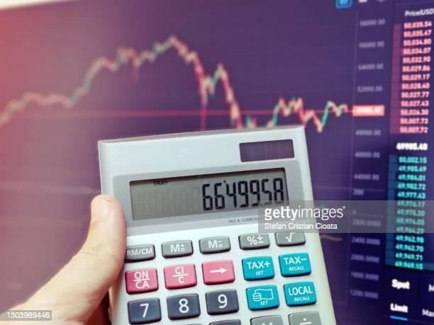 calculator in front of graphic chart. new financial technology concept. crypto and block chain. - cristian neri foto e immagini stock