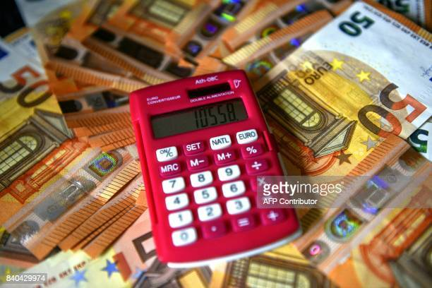 A calculator is placed for an illustration on fifty euro banknotes in Arras northern France on August 29 2017 The new 50 euro banknote was introduced...