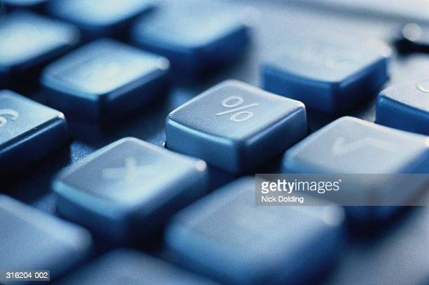 calculator keypad, close-up on percentage button, blurred effect - percentage sign stock pictures, royalty-free photos & images