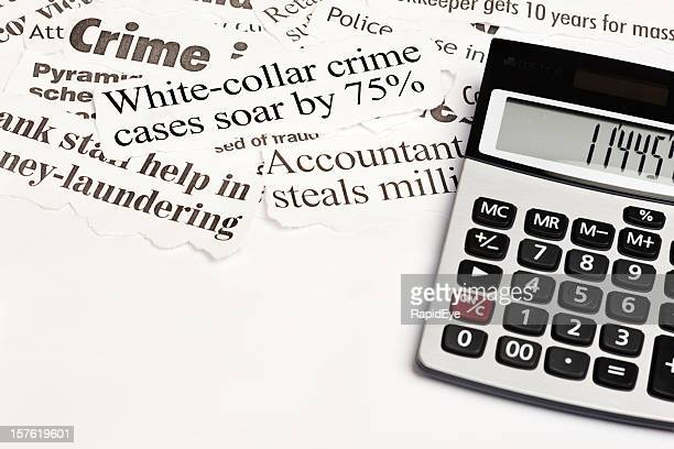 calculator next to headlines about white collar crime - money laundering stock photos and pictures