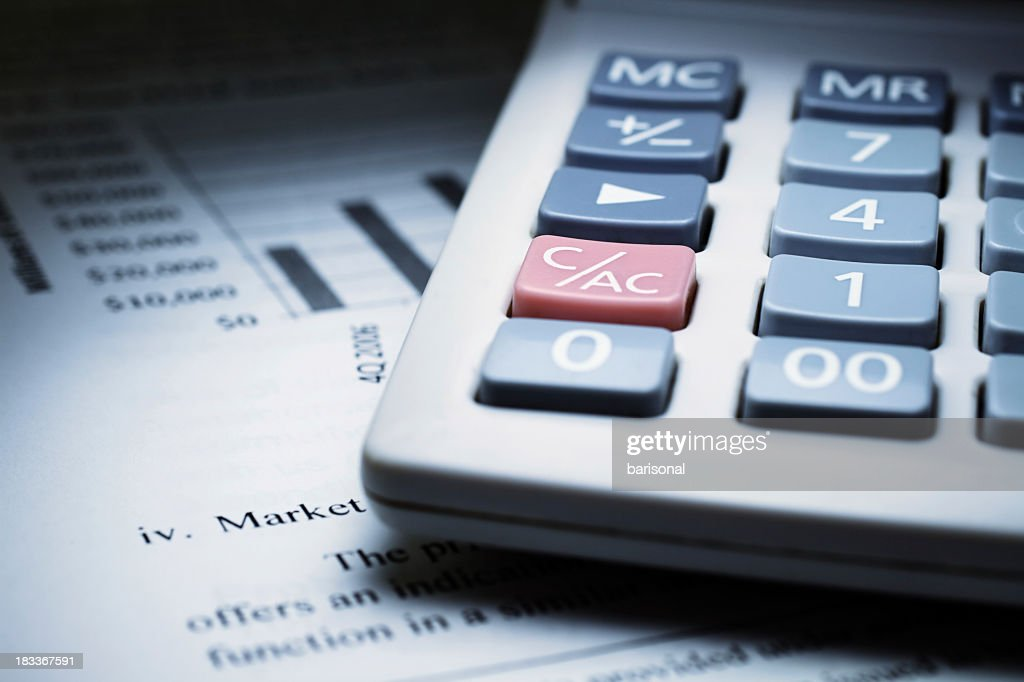 Calculator on chart of financial analysis and graphs : Stock Photo