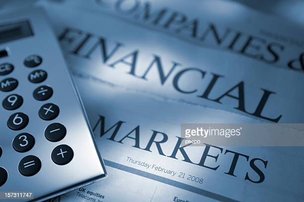 calculator on financial newspapers - western script stock pictures, royalty-free photos & images