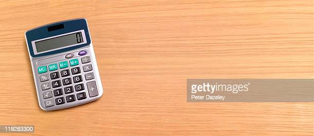 calculator on wooden background with copy space