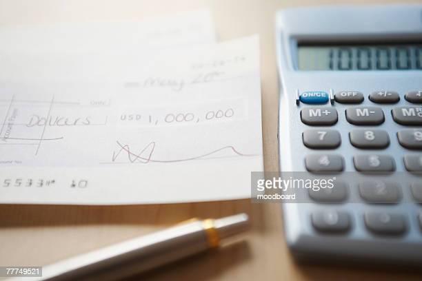Calculator, Pen and Check